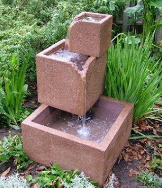 Фонтанчик из бетона для сада
